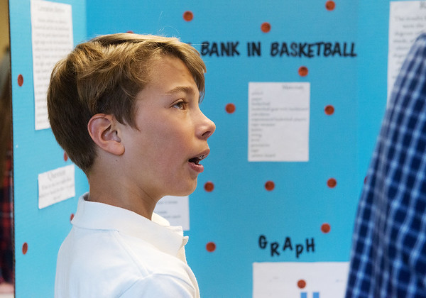 Globe/Roger Nomer<br /> Ethan Satterlee, a seventh grader at College Heights, tells a judge about his project on Tuesday at the Science Fair at Missouri Southern.