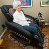 Mary Tullis, mother of Enlight Inn owner Christa Tullis, sits in a therapeutic massage chair at the inn on Wednesday.<br /> Globe | Laurie Sisk