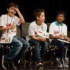 Globe/Roger Nomer<br /> Brodie Lane, a sixth grader at North Middle School, gives a thumbs up to his family as he sits with late-round spellers Cameron Nolen, middle, a fifth grader at Fairland Elementary, and Prithvi Nagarajan, a fifth grader at Thomas Jefferson, during Monday's Joplin Globe Spelling Bee at Thomas Jefferson Independent Day School.