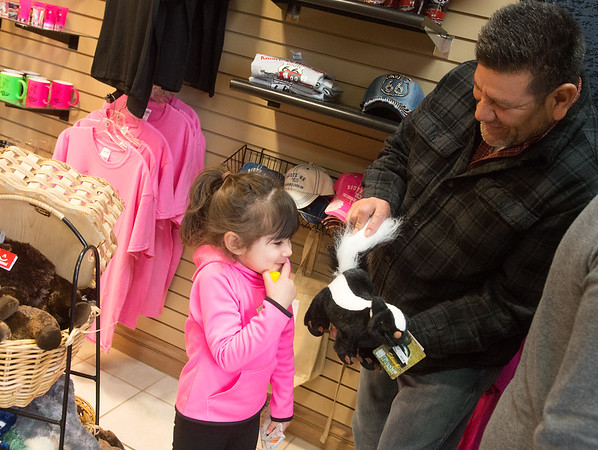 Globe/Roger Nomer<br /> Ruben Comparan, Westchester, Ohio, jokes with his daughter Isabella, 4, with a stuffed skunk on Wednesday at the Miami Travel Info Center.