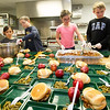 From the left: Katelyn Giddens, 9,  Mayson Meredith, 10, Adalynn Osborn, 10 and Tristan Baum, 10 plate up dinner for kids in the afterschool program at the Boys and Girls Club of Southwest Missouri on Wednesday.<br /> Globe | Laurie Sisk