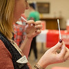 Globe/Roger Nomer<br /> Lauri Lyerla, Neosho, swabs her cheek on Friday during a bone marrow screening event at First Baptist Church in Neosho.