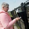 Globe/Roger Nomer<br /> Catherine Vessey uses her card to enter the dog park in Parr Hill Park on Tuesday afternoon.