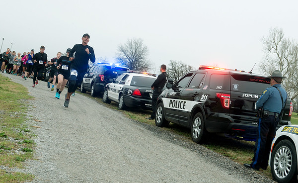 Globe/Roger Nomer<br /> Police cars line the starting route of the Officer Down 5K on Saturday in Landreth Park. Officers Down 5K is a national organization that sponsors races across the country to support law enforcement, and was held locally in partnership with the Southwest Missouri Regional Fraternal Order of Police Lodge #27 and the  Jasper County Sheriff's Office, in support of Deputy Nolan Murray.