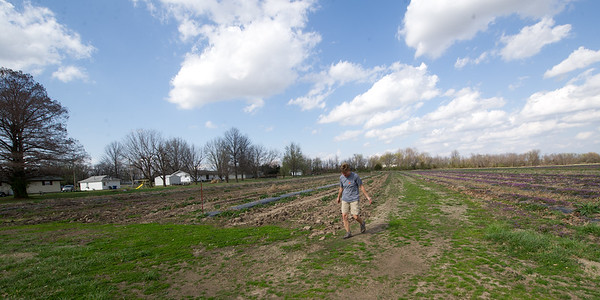 Tami Fredrickson, of Fredrickson Farms, on Thursday walks an area where she plans to plant sweet corn on her Carl Junction farm. Fredrickson is waiting for the last freeze of the year before planting.<br /> Globe   Laurie Sisk