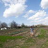 Tami Fredrickson, of Fredrickson Farms, on Thursday walks an area where she plans to plant sweet corn on her Carl Junction farm. Fredrickson is waiting for the last freeze of the year before planting.<br /> Globe | Laurie Sisk