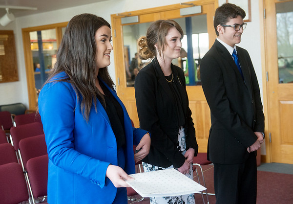 Globe/Roger Nomer<br /> (from left) Emily Henson, Seneca senior, Emily Horine, junior, and Slade Woodward, senior, give their pitch for a food delivery service on Wednesday at Crowder College.