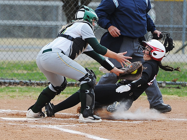 Globe/Roger Nomer<br /> Central Missouri's Alexis Koop slides by Missouri Southern's Kaycee Hodgson to score on Wednesday.