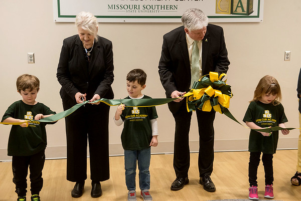 Globe/Roger Nomer<br /> Children from the Lion Cub Academy helps Deborah Brown, dean of the School of Education, and Missouri Southern President Alan Marble cut the ribbon on the new childcare center on Tuesday.