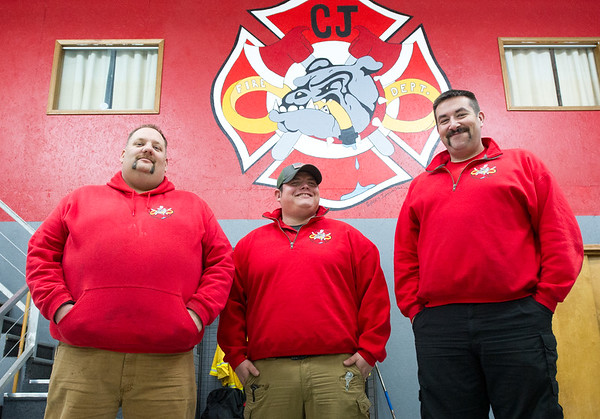 From the left: Carl Junction firefighters Scott Skoglund, Rueben Basaldua and Chief Joe Perkins stand inside the Carl Junction Fire Department last week. Basaldua is a full-time firefighter for Carl Junction, while Skoglund is a volunteer who works full-time for the Redings Mill Fire Department. Chief Perkins said about half of his volunteers also work for other departments.<br /> Globe   Laurie Sisk