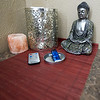 An aromatherapy candle sits beside a massage table at the Enlight Inn on Wednesday.<br /> Globe | Laurie Sisk