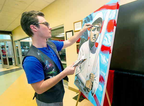 Artist Jordan Wood, of Mythiq, puts some finishing touches on a portrait of baseball legend Babe Ruth during the Carl Junction Business Expo on Saturday morning at the Carl Junction Community Center.<br /> Globe | Laurie Sisk