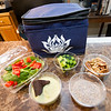 """A snack tote featuring healthy, fresh made items is available at the cafe drive thru at the Enlight Inn. The cafe also offers a selection of """"superfood"""" smoothies and coffee.<br /> Globe 