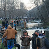 Globe/Roger Nomer<br /> Fishers line the banks of Roaring River on Wednesday during opening day at Roaring River State Park.