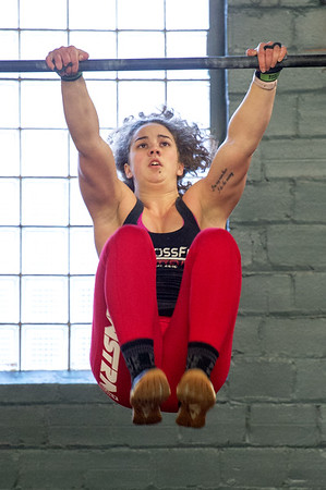Taylor Blackburn works out on the bars on Tuesday at Midwestern Built.<br /> Globe | Laurie Sisk