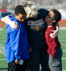 Michelle Daugherty, center, hugs her son, Jeremy Daugherty, 10 and family friend Garren Berry, 11, during a vigil for Joplin High School student Spencer Nicodemus, who died Thursday morning in an accident at Irving Elementary School. Daugherty's older son, Nate Daugherty, was close friends with Nicodemus. Globe | Laurie SIsk