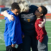 Michelle Daugherty, center, hugs her son, Jeremy Daugherty, 10 and family friend Garren Berry, 11, during a vigil for Joplin High School student Spencer Nicodemus, who died Thursday morning in an accident at Irving Elementary School. Daugherty's older son, Nate Daugherty, was close friends with Nicodemus.<br /> Globe | Laurie SIsk
