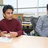 From the left: Pittsburg State University graduate student Charith Ranaweera and his professor, Dr. Ram Gupta, talk about the possible applications of a fire retardent foam made from orange peels on Wednesday at the Kansas Polymer Research Center at PSU.<br /> Globe | Laurie Sisk
