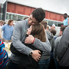 Globe/Roger Nomer<br /> Nate Daugherty, Joplin High senior, embraces Sam Nicodemus, sister of Spencer Nicodemus, on Monday morning during a breakfast in honor of Spencer Nicodemus in the parking lot of Joplin High School.