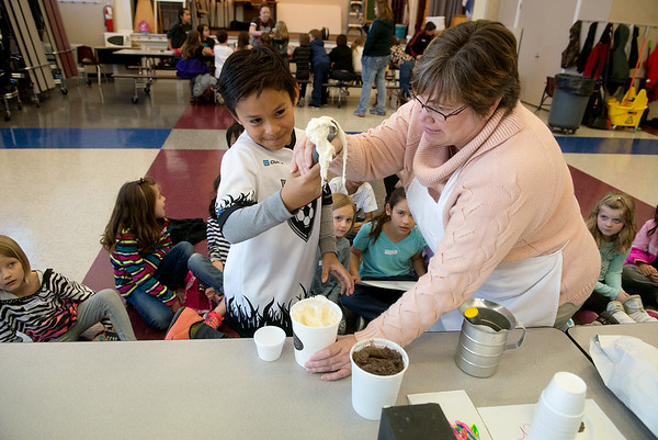 Globe/Roger Nomer<br /> Ginger Sweet, manager of Sweet Caroline's, helps Ely Montanez, a fourth grader at Columbia Elementary, scoop ice cream on Friday during a job fair at the school.