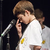 Globe/Roger Nomer<br /> Brodie Lane, a sixth grader at North Middle School, pauses to concentrate before spelling a word in the late rounds of Monday's Joplin Globe Spelling Bee at Thomas Jefferson Independent Day School. Lane took second place in the bee.