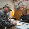 Globe/Roger Nomer<br /> Scott Graham, Ludington, Mich., talks with Shanda Schetz while signing in on Wednesday at the Miami Travel Info Center.