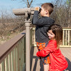 Globe/Roger Nomer<br /> Ava Jackson, 9, Webb City, helps her brother Brody, 6, look through the scope at Wildcat Glades on Tuesday as sister Ella, 9, waits her turn.