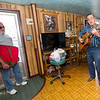 From the left: Meals on Wheels volunteer Mike Howard listens as Sonny Lau plays a tune during a meal delivery on Thursday morning at Lau's Joplin home. Howard, a 13-year volunteer for the program, said part of the job is getting to know the people to whom he delivers.<br /> Globe | Laurie Sisk
