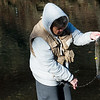 Globe/Roger Nomer<br /> Nancy Hassler, Cape Fair, puts her catch on a stringer on Wednesday during opening day at Roaring River State Park.