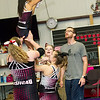 Sean Haase watches as his girls perform a stunt during practice at the Flip Shop Cheer Zone in Webb City  on March 16. In addition to coaching the girls, Haase also flies a medical helicopter.<br /> Globe | Laurie Sisk