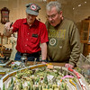 Globe/Roger Nomer<br /> Buddy Yockey, Carthage, uses a lazer pointer to show features of his train set to Benny Perry, Webb City, during Saturday's Train Show at the Schifferdecker Museum Complex.