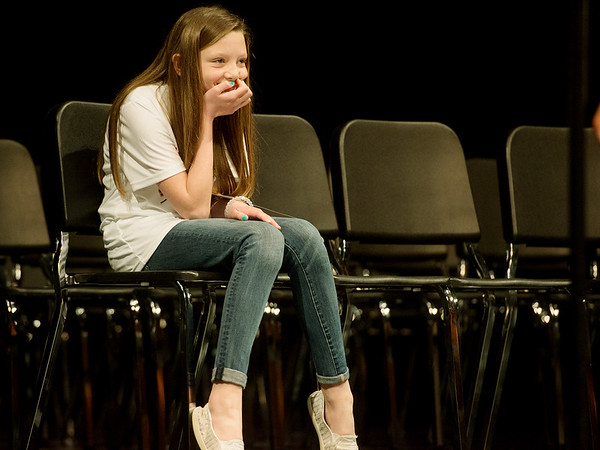 Globe/Roger Nomer<br /> Khloe Rhuems, a fifth grader at Webb City Middle School, reacts to correctly spelling a word to make it to the top two during Monday's Joplin Globe Spelling Bee at Thomas Jefferson Independent Day School. Rhuems tooks second place in the bee.