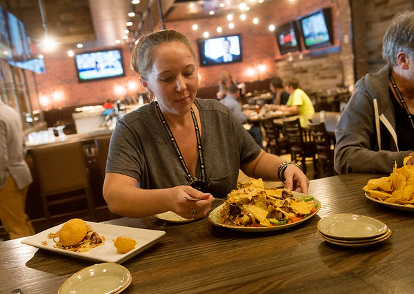 Globe/Roger Nomer<br /> Amanda Lee, Pittsburg, a winner of a social media contest to get a tour of the casino, samples food at Kansas Crossing Casino on Thursday.