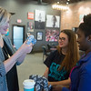 Globe/Roger Nomer<br /> Whitney Herrod, director of merchandise at Rapha House, talks with Karli Hardy, middle, College Heights sophomore, and Nyasha Bgoni, junior, about checking stuffed animals on Monday at Rapha House.