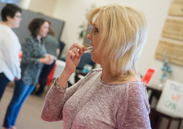 Globe/Roger Nomer<br /> Kim Camerer, Granby, swabs her cheek on Friday during a bone marrow screening event at First Baptist Church in Neosho.