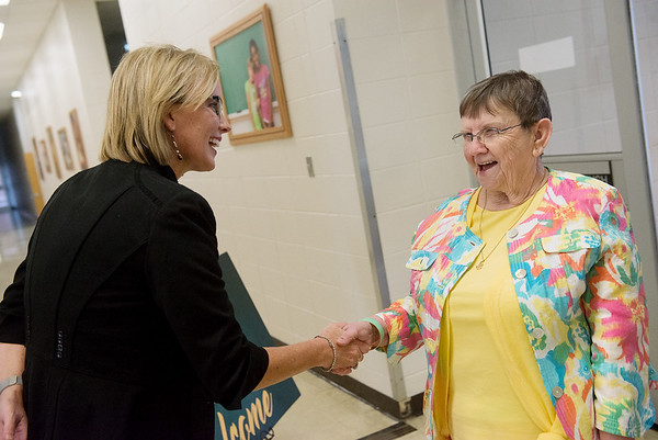Globe/Roger Nomer<br /> Michelle Wood, director of leadership at Missouri Southern, greets Myrna Richardson, Webb City, on Friday for the Joplin Junior College reunion at the Memorial Education Center. Richardson is an alumi of the school.