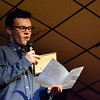 Globe/Sierra Gray<br /> Ryan Drenel, a Missouri Southern sophomore from Chicago, reads from the stage during his book drive on Friday at Joplin Avenue Coffee.