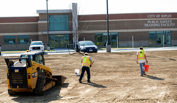 Crews work Thursday on landscaping the exterior of the new City of Joplin Public Training Safety Facility.<br /> Globe | Laurie Sisk