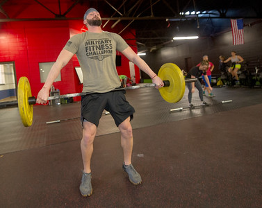 Kyle Doss works out during a cross fit class on Tuesday at Midwestern Built. Globe | Laurie Sisk