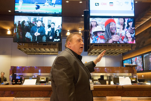 Globe/Roger Nomer<br /> Doug Fisher, vice president and general manager of the Kansas Crossing Casino, gives a tour of the bar area on Thursday.