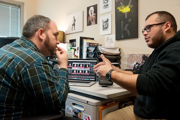 Globe/Roger Nomer<br /> Chauncey Huffman, assistant professor of graphics and imaging technology at Pittsburg State, meets with Pablo E. Ortiz, a Pittsburg State senior from Joplin, on Wednesday at his office about a photo project.