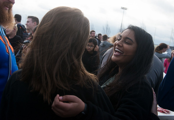 Globe/Roger Nomer<br /> Tulsi Nursariwala, right, senior, talks with Sam Nicodemus on Monday during a breakfast in honor of Spencer Nicodemus at Joplin High School.
