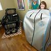 Marcia Brandon, sister of Mary Tullis, mother of Enlight Inn owner Christa Tullis, demonstrates the infrared sauna at the inn on Wednesday.<br /> Globe | Laurie Sisk