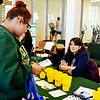 Globe/Sierra Gray<br /> Arianna Penate, a Missouri Southern freshman from Carthage, speaks with Marie-Laure Firebaugh, a representative from Washington University in St. Louis, on Wednesday during the Wellness Expo in Billingsly Student Center at Missouri Southern.