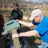 Globe/Roger Nomer<br /> Volunteers John Greenwood, right, and Mike Hamilton work on construction of the Eagles Nest playground on Tuesday at Wildcat Glades Nature Center.