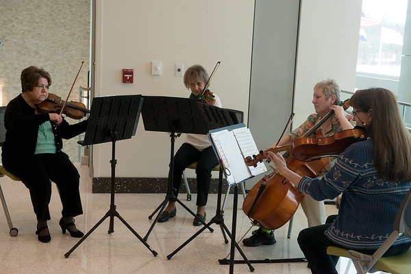 Globe/Roger Nomer<br /> The Heritage String Quartet of (from left) Roberta Worley, Lucy Gilbert, Ann Davy and Marcia Ball play a selection of Irish songs on Friday at Mercy Hospital on St. Patrick's Day. The quartet's concert was also in honor of the memory of Catherine McAuley, who founded the Sisters of Mercy in Dublin in 1827, the founding organization of the Joplin Hospital.