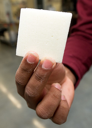 Pittsburg State University graduate student Charith Ranaweera holds a sample of the fire retardent foam he devolped using orange peels.<br /> Globe | Laurie Sisk