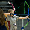 Joplin High School freshman Leigh Maile sets her sights on the bullseye during the Academy Outdoors Shootout on Saturday at Missouri Southern. Archers from about 30 schools participated in the day long competition.<br /> Globe | Laurie Sisk