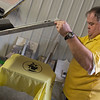 Globe/Roger Nomer<br /> Jim Davis inks a shirt dedicated to RJ Daniels on Monday at G & S Graphix.