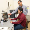 From the left: Pittsburg State University graduate student Charith Ranaweera works with his professor, Dr. Ram Gupta, at PSU's Kansas Polymer Research Center on Wednesday. Ranaweera has designed a fire retardent foam made from orange peels.<br /> Globe | Laurie Sisk